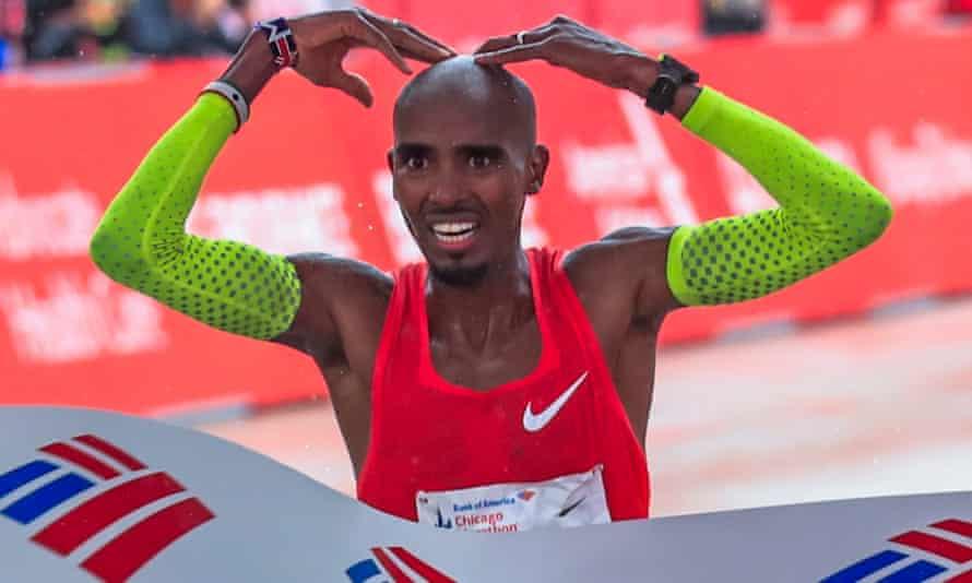 Mo Farah celebrates as he crosses the line to win the Chicago marathon