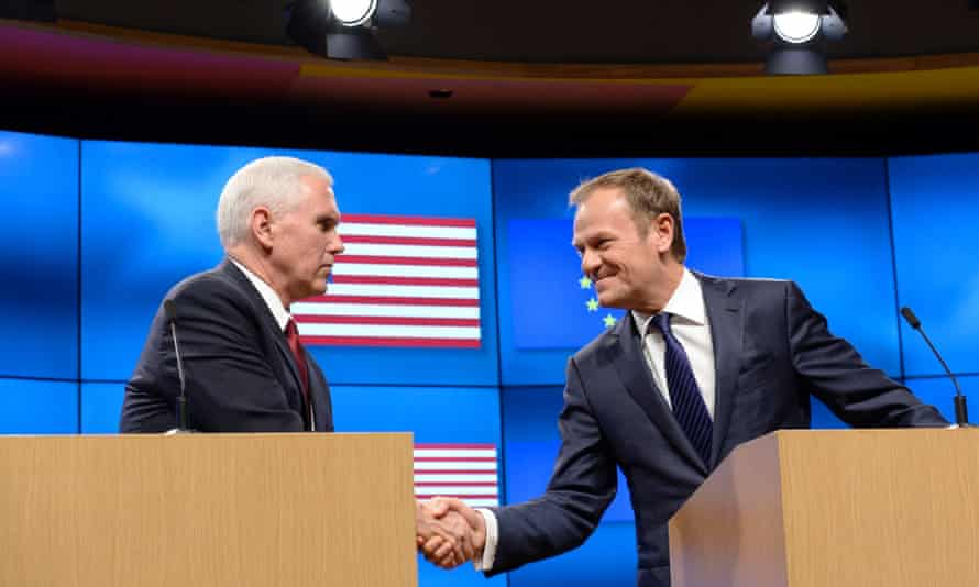 Mike Pence (left) shakes hands with Donald Tusk during a press conference at the European commission in Brussels.
