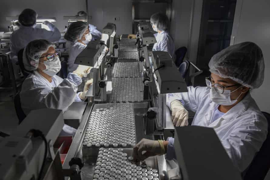 Employees work on the production line of CoronaVac, Sinovac Biotech's vaccine against Covid, at the Butantan biomedical production centre, in Sao Paulo, Brazil.