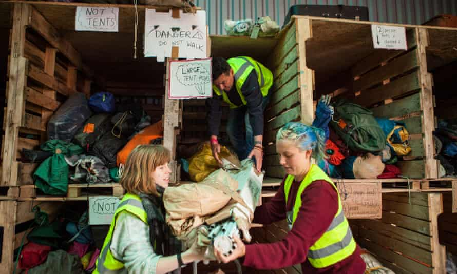 Help Refugees volunteers sorting donated tents at the warehouse in Calais.