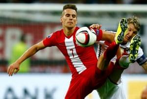 Poland's Milik challenges Schweinsteiger in Frankfurt.