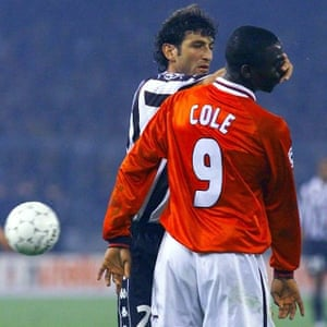 Juventus' Ciro Ferrara pushes his hand into the face of Manchester United's Andy Cole.