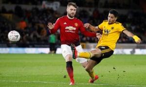 Wolverhampton Wanderers' Raul Jimenez gets the better of Manchester United's Luke Shaw.