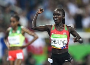 Kenya's Vivian Jepkemoi Cheruiyot celebrates her victory in the women's 5000m final.