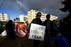Protesters are seen holding signs during an anti-U.S. President Donald Trump demonstration in a camp they have set up outside Shannon Airport in Shannon, Ireland, June 5.