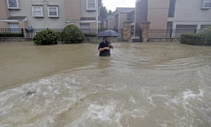 A man up to his waist in water in Houston.