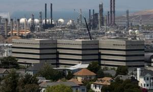 Homes stand amidst the Chevron oil refinery in Richmond, California