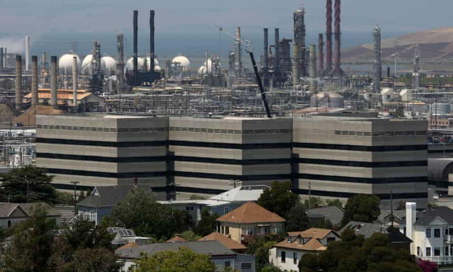 Homes stand amidst the Chevron oil refinery in Richmond, California