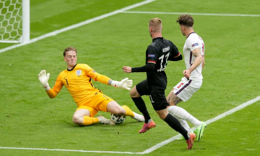 Jordan Pickford of England saves the shot by Timo Werner of Germany