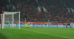 Olympiacos goalkeeper Roberto is sent the wrong way and the ball's in the net for Olivier Giroud's hat-trick.