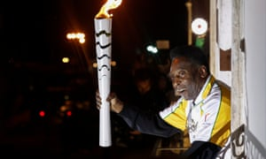 Pelé holding the Olympic flame at the Pelé Museum in Santos last month.