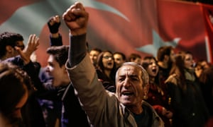 Protesters raise their fists during a demonstration in support to the Turkish daily newspaper Cumhuriyet.