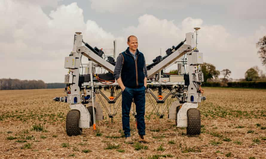 Craig Livingstone in front of the weed-zapping robot Dick