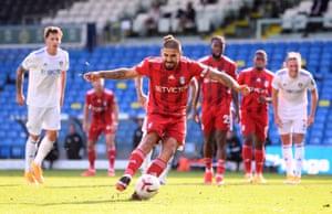 Fulham's Aleksandar Mitrovic scores the equaliser from the spot.