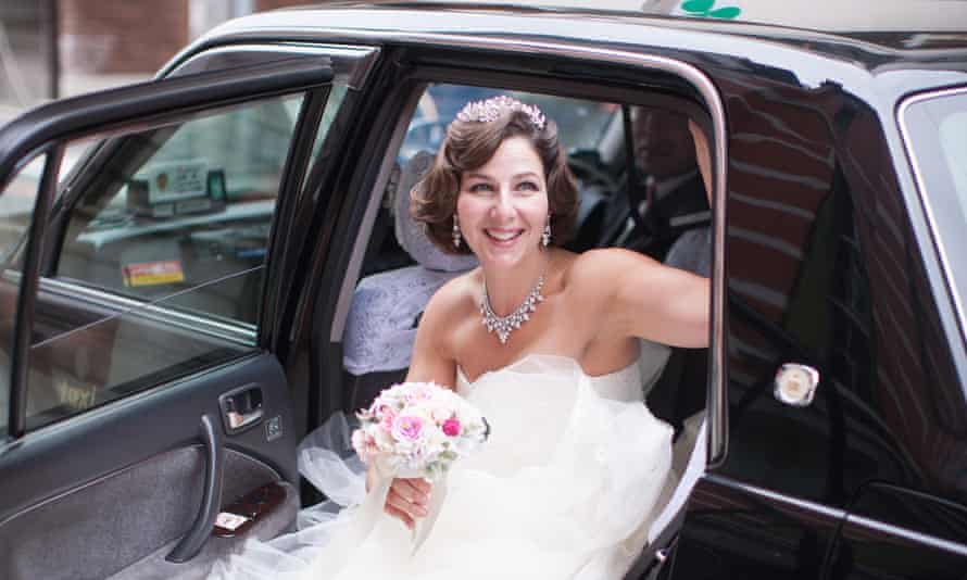 Naomi Harris getting out of a wedding car, wearing a wedding dress and holding a bouquet