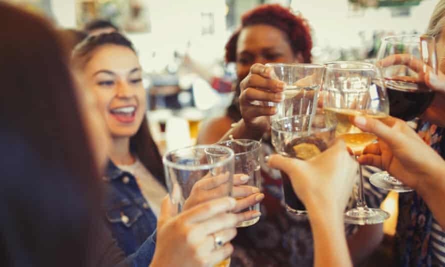 Women raising a toast in a pub