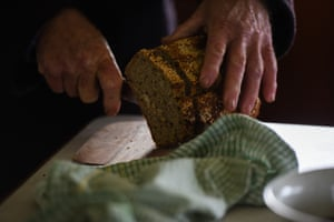 Pascoe slices the loaf of bread made from the mandadyan nalluk flour.