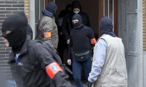 Belgium police leave after an investigating in a house in the Anderlecht neighborhood of Brussels.