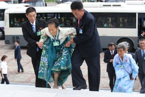 North Koreans arrive at a hotel to meet their South Korean relatives on the second day of a separated family reunion event.