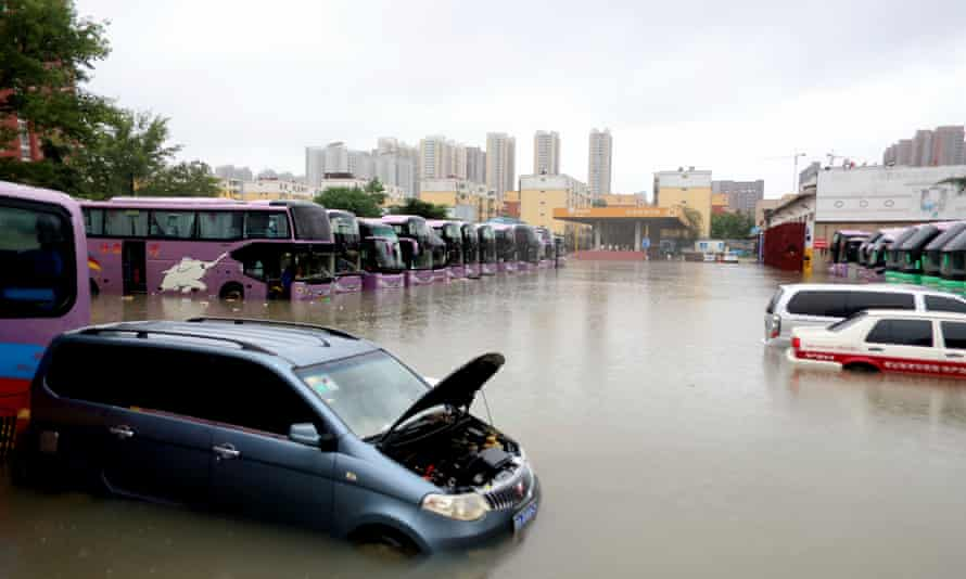 Vehicles inundated by flood water in Zhengzhou.