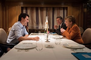 Berlin, Germany Justin Trudeau, Prime Minister of Canada at the dinner table with German Chancellor Angela Merkel and her security advisor Christoph Heusgen at the Regent Hotel