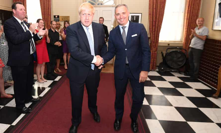 Boris Johnson shaking hands with cabinet secretary Mark Sedwill, who stepped down in September 2020.