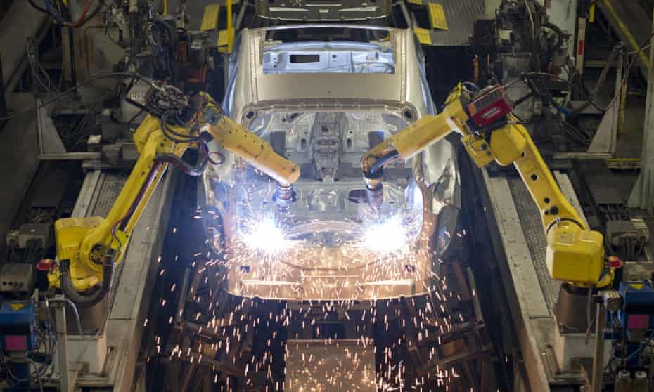 Robots weld vehicle panels at the Nissan plant in Sunderland.