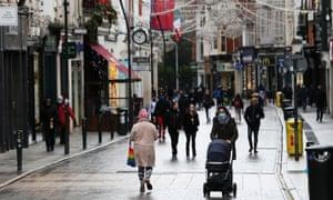 People walk on Grafton Street in Dublin.