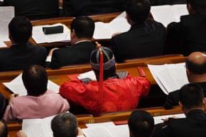 Delegates read a report