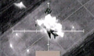 A video grab shows a still image of cockpit video of an undated attack by US-led forces over Iraq, which was shown at the daily military briefing in Qatar, 31 March 2003