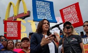 Democratic presidential candidate Sen. Kamala Harris, D-Calif., speaks to people protesting for higher minimum wage outside of McDonald's, Friday, June 14, 2019, in Las Vegas. (AP Photo/John Locher)
