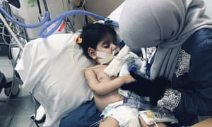 Shaima Swileh holds her dying two-year-old son Abdullah at a hospital in Oakland, California.