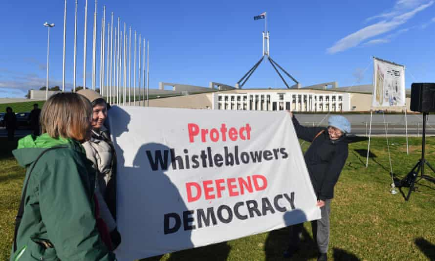 Protesters hold a banner at a rally in support of Witness K and Bernard Collaery in front of Parliament House in Canberra on 17 June 2021