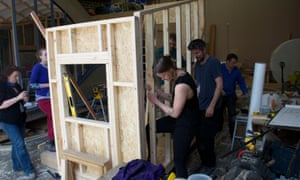 Students get down to attaching a side wall
