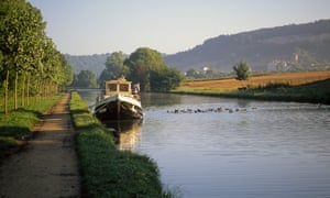 A boat moored up on the tranquil Burgundy Canal, eastern France.