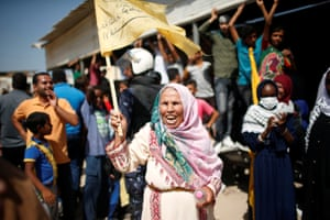 Gaza Strip. A Palestinian woman cheers as she waits for the arrival of the prime minister, Rami Hamdallah, and his government at Erez crossing