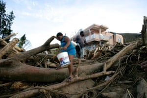 A father and son search for clean water in Castle Comfort, a small community in the parish of St George
