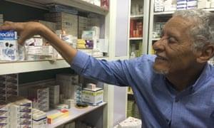 Hathim Ahmed in his pharmacy near Khartoum's main children's hospital
