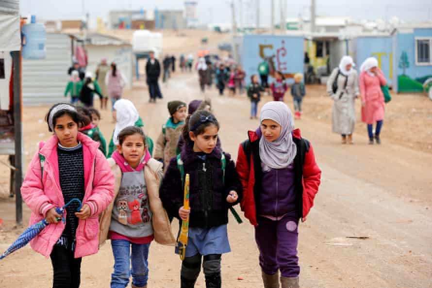 Syrian refugee children walk to school at the Zaatari refugee camp in the Jordanian city of Mafraq, near the border with Syria, December 2016
