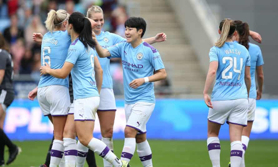 Lee Geum-min is congratulated after adding a late third.