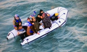 Migrants aboard a rubber boat in the English Channel after being intercepted by French authorities off Calais.