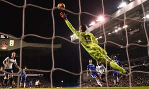 Dele Alli heads the ball past the despairing dive of Thibaut Courtoi
