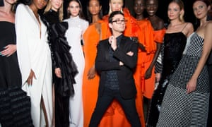 Christian Siriano encircled by a group of well-dressed women