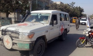 Taliban fighters driving a Red Cross vehicle in Kunduz