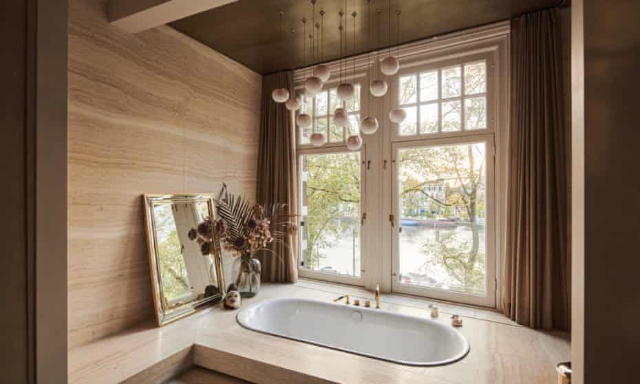 The bathroom, with views across the Amstel river