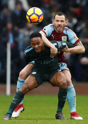 Manchester City's Raheem Sterling is held back by Burnley's Phil Bardsley during the 1-1 draw at Turf Moor.