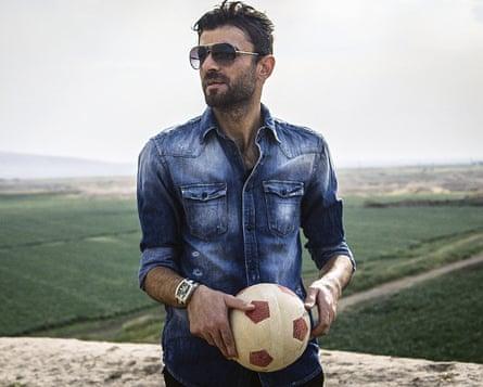 Kurdistan football team captain Khaled Musher, holding a football