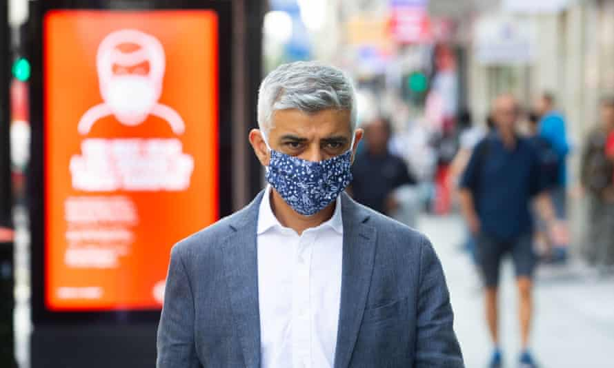 Sadiq Khan wears a face mask on a visit to Oxford Street in central London.