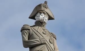 Lord Nelson's statue wearing a breathing mask in Trafalgar Square, London.