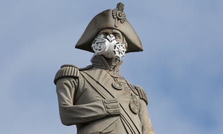 Lord Nelson's statue wearing a breathing mask in Trafalgar Square, London.
